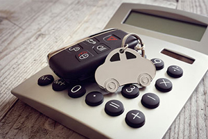 Calculator with car keys on top of keypad