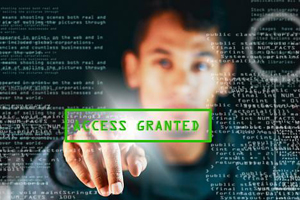 "Reflection of man over program code pressing ""access granted"" button"