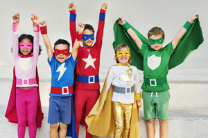 Five children dressed up in colorful homemade superhero outfits