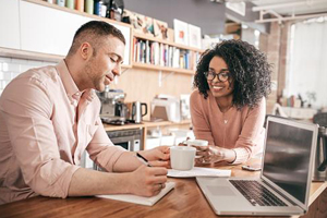 Young couple plans out payments at kitchen table